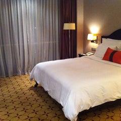 Photo taken at Eastin Grand Hotel Saigon by Mew M. on 10/5/2013