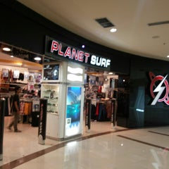 Photo taken at Planet Surf by anam a. on 3/30/2014