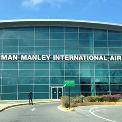 Photo taken at Norman Manley International Airport (KIN) by Andre C. on 5/27/2013