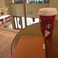 Photo taken at Starbucks by Nick W. on 12/13/2012