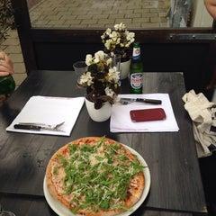 Photo taken at YamYam Trattoria Pizzeria by Sarah C. on 6/21/2015