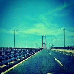Photo taken at Jembatan Suramadu (Suramadu Bridge) by Fauzan A. on 11/29/2012