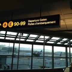 Photo taken at Gate 95 by Bew B. on 10/16/2012