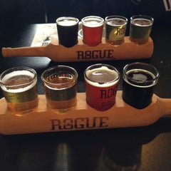 Photo taken at Rogue Ales Public House by Nikki P. on 5/13/2013