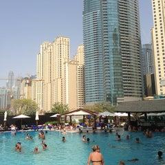 Photo taken at Hilton Dubai Jumeirah Resort by Rami A. on 8/30/2013