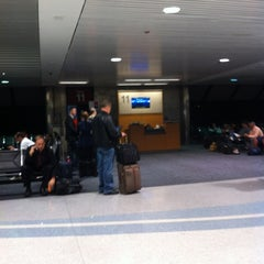 Photo taken at Gate 11 by Chris D. on 10/26/2012