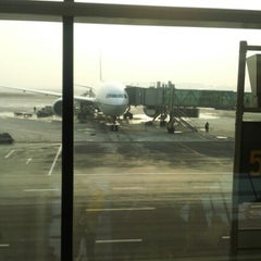 Photo taken at Gate E23 by Ino P. on 1/15/2013