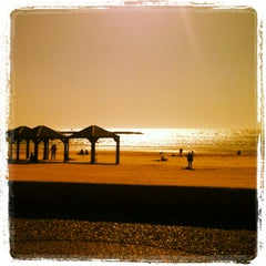 Photo taken at Frishman Beach (חוף פרישמן) by Paula L. on 4/25/2013