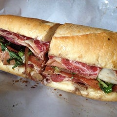 Photo taken at Graham Avenue Meats and Deli by Stanley L. on 7/28/2013