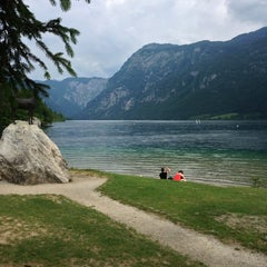 Photo taken at Bohinjsko jezero (Bohinj Lake) by Serkan B. on 6/23/2013