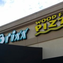 Photo taken at Brixx Wood Fired Pizza by C R. on 7/9/2013