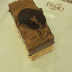 Photo taken at Figaro Café by Fred O. on 3/11/2013