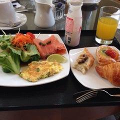 Photo taken at Azie Grand Café by shun S. on 8/1/2014