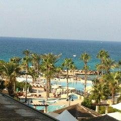 Photo taken at Adams Beach Hotel by Anastasi on 8/15/2012