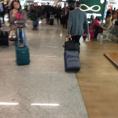 Photo taken at Terminal 1 by Andrea R. on 4/17/2013