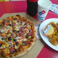Photo taken at Domino's Pizza by Sibel U. on 4/6/2015