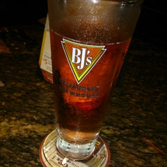 Photo taken at BJ's Restaurant and Brewhouse by Amanda S. on 5/19/2013