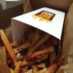 Photo taken at Box Frites by The Corcoran Group on 7/22/2013