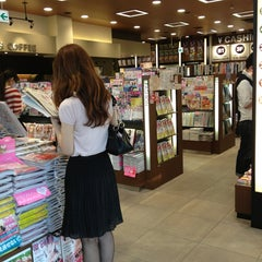 Photo taken at TSUTAYA BOOK STORE TENJIN by ipc10396 on 5/23/2013