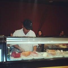 Photo taken at Mizu Sushi Steak Seafood by Carol S. on 12/19/2014