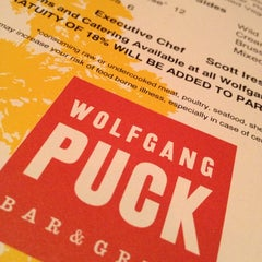 Photo taken at Wolfgang Puck Bar & Grill by Carla T. on 5/17/2013