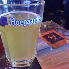 Photo taken at Island Dogs Bar by Brian A. on 1/26/2016