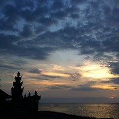 Photo taken at Pantai Penimbangan by Theo P. on 7/31/2014