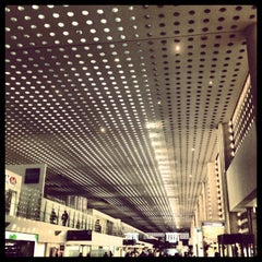 Photo taken at Terminal 2 by Alexis T. on 3/9/2013