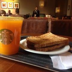 Photo taken at Starbucks by Adrien D. on 8/15/2014