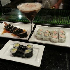 Photo taken at Sushi Axiom by Edwina P. on 2/19/2013