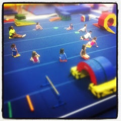 Photo taken at Gymnastics Academy of Boston by sɐןoɥɔıu ן. on 5/19/2012