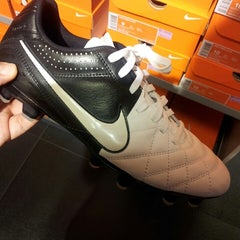 Photo taken at Nike Factory Store by Andrew H. on 9/12/2013