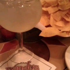 Photo taken at Nando's Mexican Cafe by Josie on 6/27/2012
