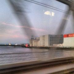 Photo taken at JR 下神崎川橋梁 by Izumi T. on 8/3/2012