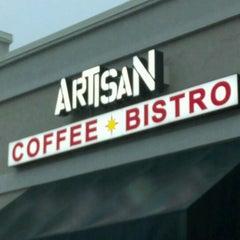 Photo taken at Artisan Coffee Bistro by Cheyenne K. on 5/5/2012