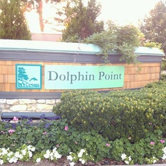 Photo taken at Dolphin Point by K G. on 6/16/2012