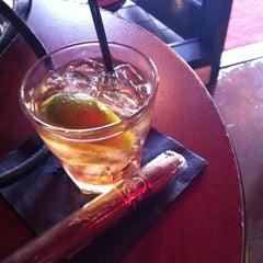Photo taken at LIT Premium Cigar Lounge by Dennis P. on 4/6/2012