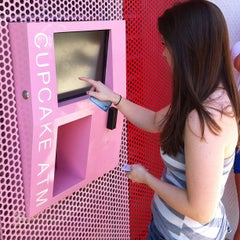 Photo taken at Sprinkles Cupcakes by Samantha and Mike T. on 9/4/2012