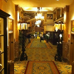 Photo taken at The Pfister Hotel by Mike R. on 3/10/2012