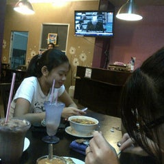 Photo taken at One Smile Bistro by nadiah A. on 3/13/2012