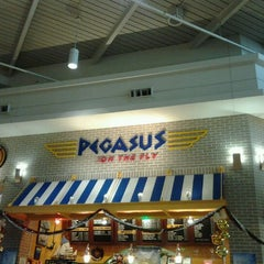 Photo taken at Pegasus on the Fly by Kat G. on 12/19/2011