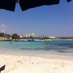 Photo taken at Makronissos beach by Robert B. on 9/1/2011