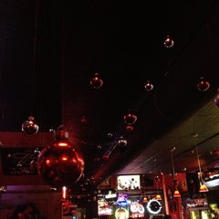 Photo taken at I.C. Ugly's Saloon by Rachael S. on 12/21/2011