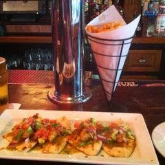 Photo taken at Social Bar, Grill & Lounge by Burt L. on 6/29/2012