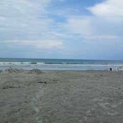 Photo taken at Cocoa Beach by Steven S. on 6/8/2012