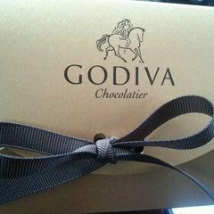 Photo taken at Godiva Chocolatier by German S. on 2/14/2012