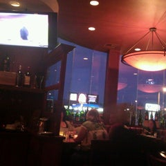 Photo taken at Fleming's Prime Steakhouse & Wine Bar by Kirk D. on 1/3/2012
