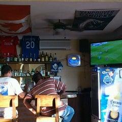 Photo taken at Sunset Bar by Walter B. on 10/23/2011