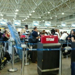 Photo taken at TAM Check-in by Mariel P. on 12/23/2011
