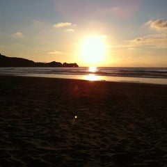 Photo taken at Playa de Salinas / San Juan de Nieva by Nuria F. on 7/23/2011